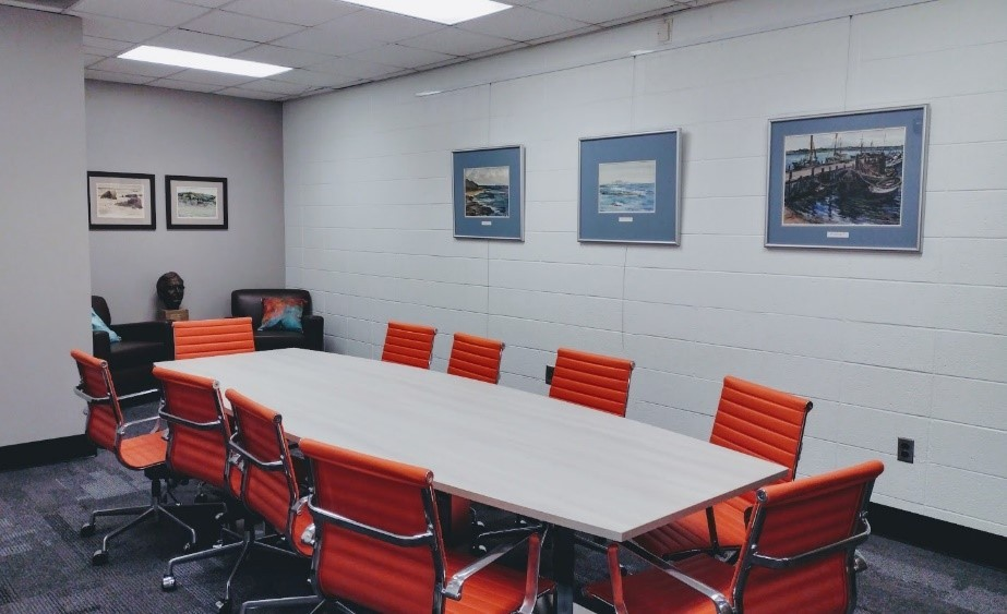 The Odum Gallery and Reading Room, with watercolors by Martha Odum on the walls, bronze bust of Eugene Odum, and a conference table and chairs.